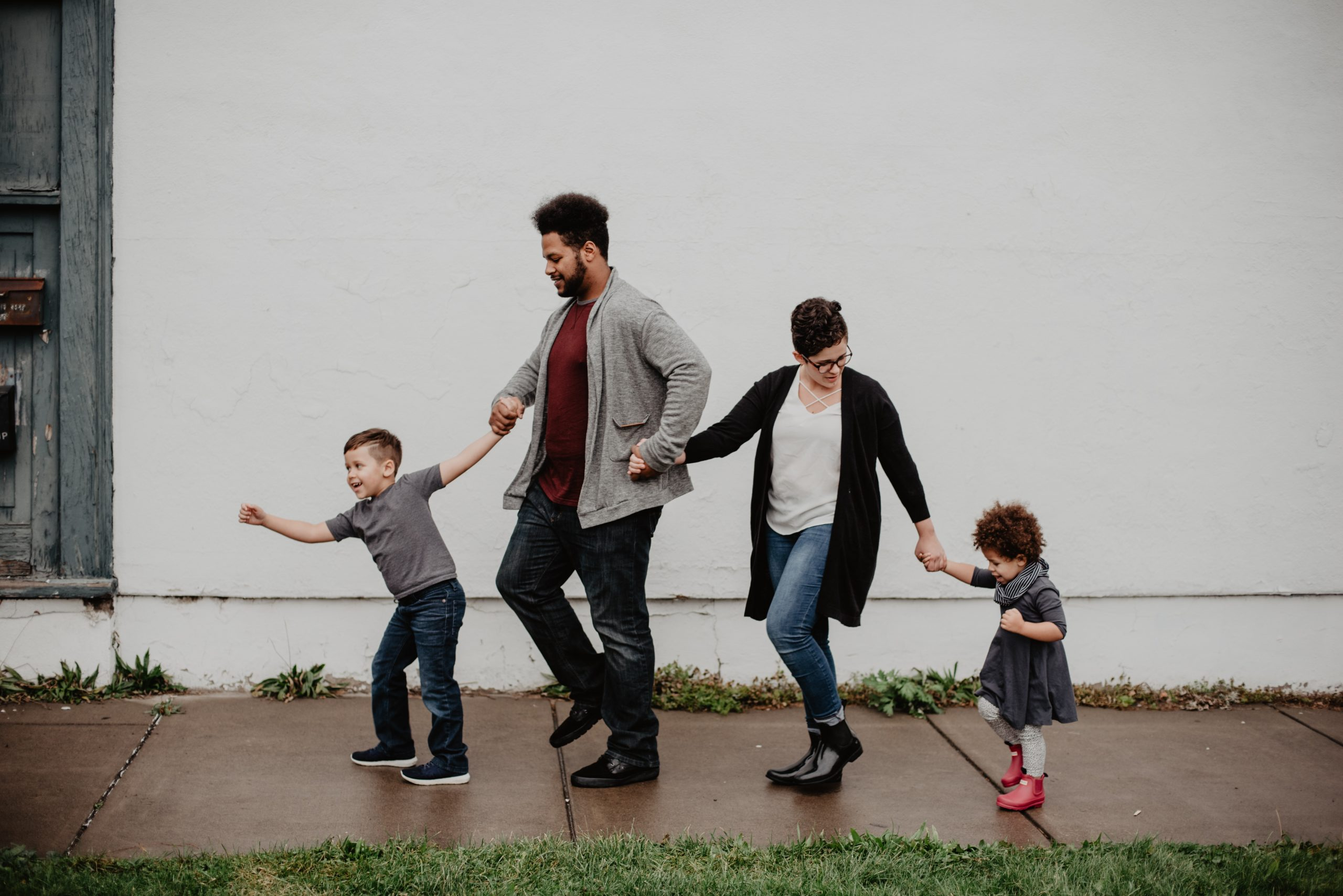 family-of-four-walking-at-the-street-2253879-scaled